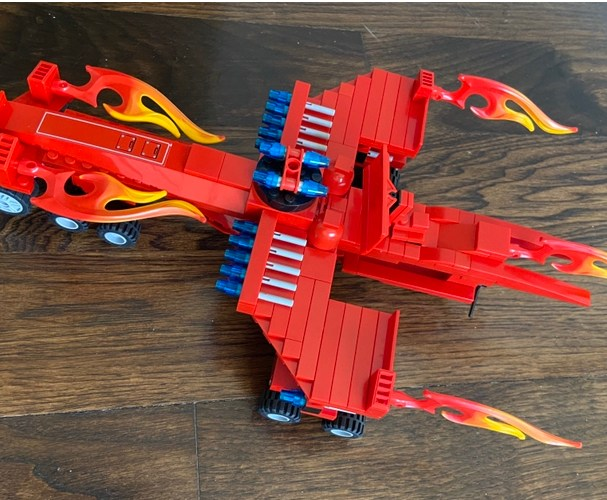 Flaming Jet: The idea came to me after finding an older creation and wanting to make a better one. This jet carries vehicles and boats, has a satellite and defense capabilities.