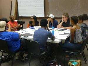 "Playwright Harrison David Rivers with actors and director for his play, ""sweet""; all eyes on him.  Director David Mendizábal in white hat, Dramaturg Jeremy White (next to Mendizábal).  Picture by Joe Luis Cedillo, Associate Artistic Director."