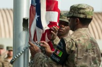 U.S. Airmen with the Bagram Airfield Honor Guard lower the U.S. Flag during the Prisoners Of War, Missing In Action Remembrance and Retreat Ceremony at BAF, Afghanistan, Sept. 17, 2015. The ceremony was in honor of National POW/MIA Remembrance Day, which is observed annually in the United States on the third Friday of September. (U.S. Air Force photo by Tech. Sgt. Joseph Swafford/Released)