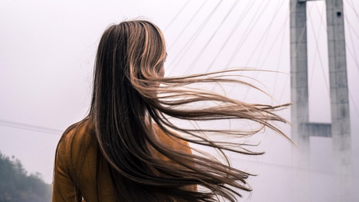 https://www.goodfreephotos.com/cache/people/girl-with-hair-blowing-in-the-wind.jpg