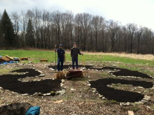 Lagom Landing students work together to spread mulch on our mandala shaped permaculture garden.