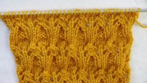 Un point tricot ajouré et en relief