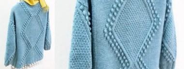 Un pull géométrique nope et grain de riz