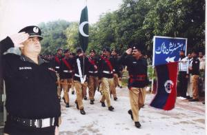 Commandant Police College Chung, Dr. Suleman Sultan Rana taking salute from passed out recruits