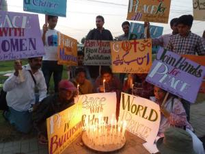 a candle Light Vigil to celebrate International Day of Peace
