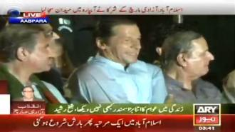 IK sitting on stage