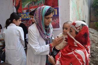 PTI vice president Dr Seemi Bukhari is examning a patient at medical camp in Shahdara
