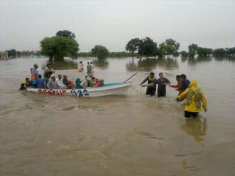 Rescuers busy in evacuating trapped persons inside flood