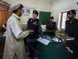 Pakistani Police Inspector Shazadi Gillani interrogates an accused kidnapper at a police station in Abbottabad