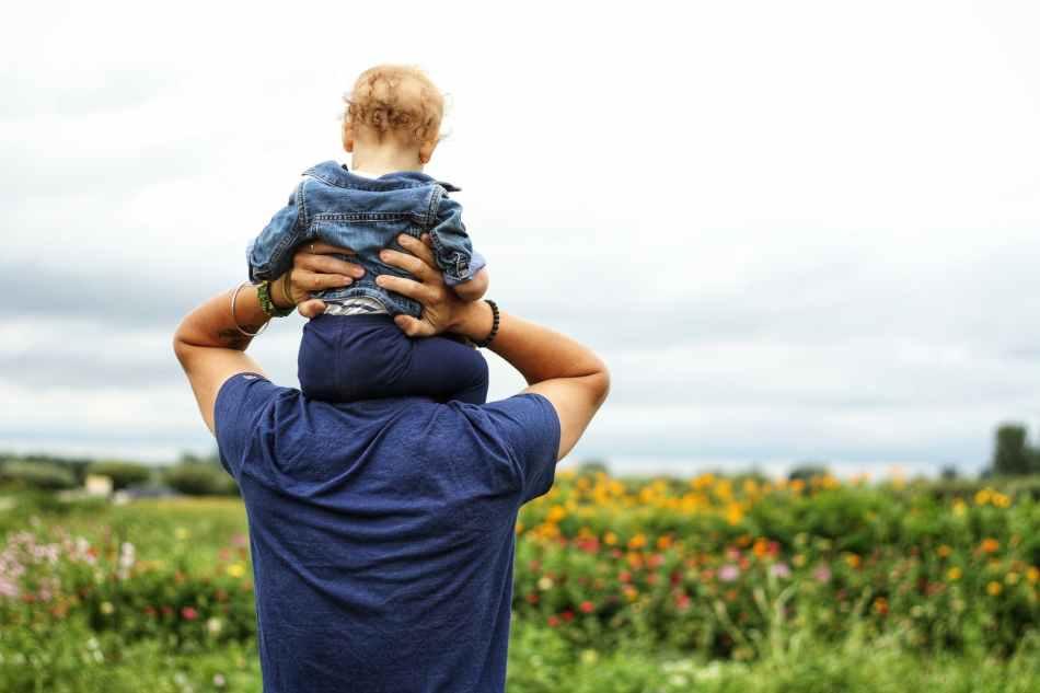 Baby on dad's shoulders.