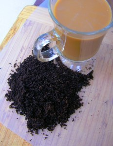 Cup of coffee with coffee grounds.