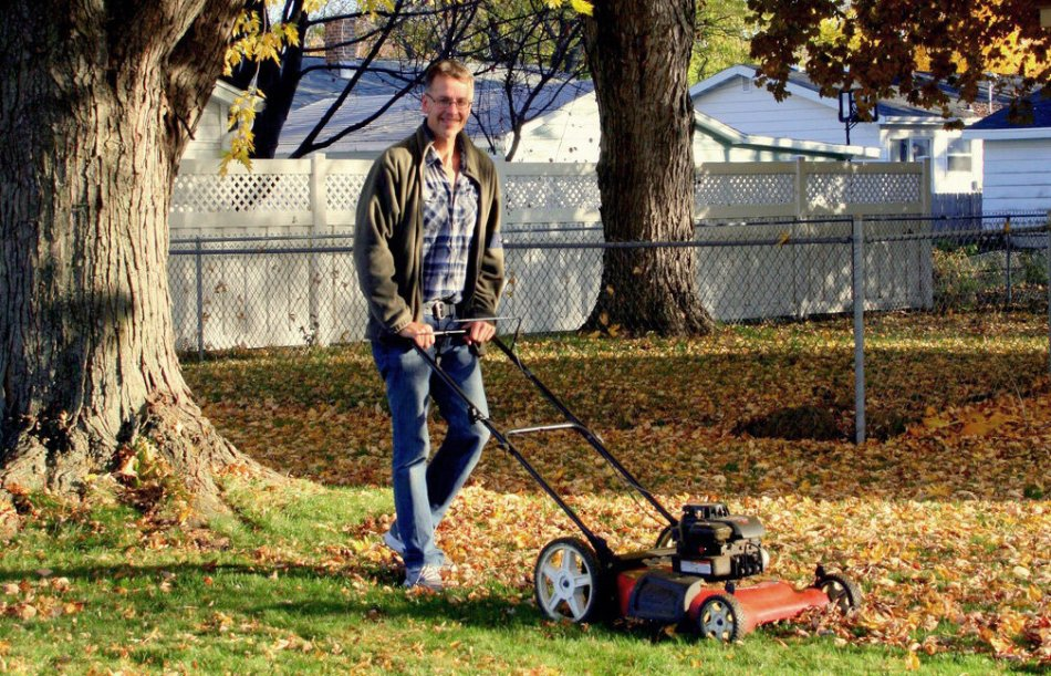 Mowing fall leaves directly on the lawn