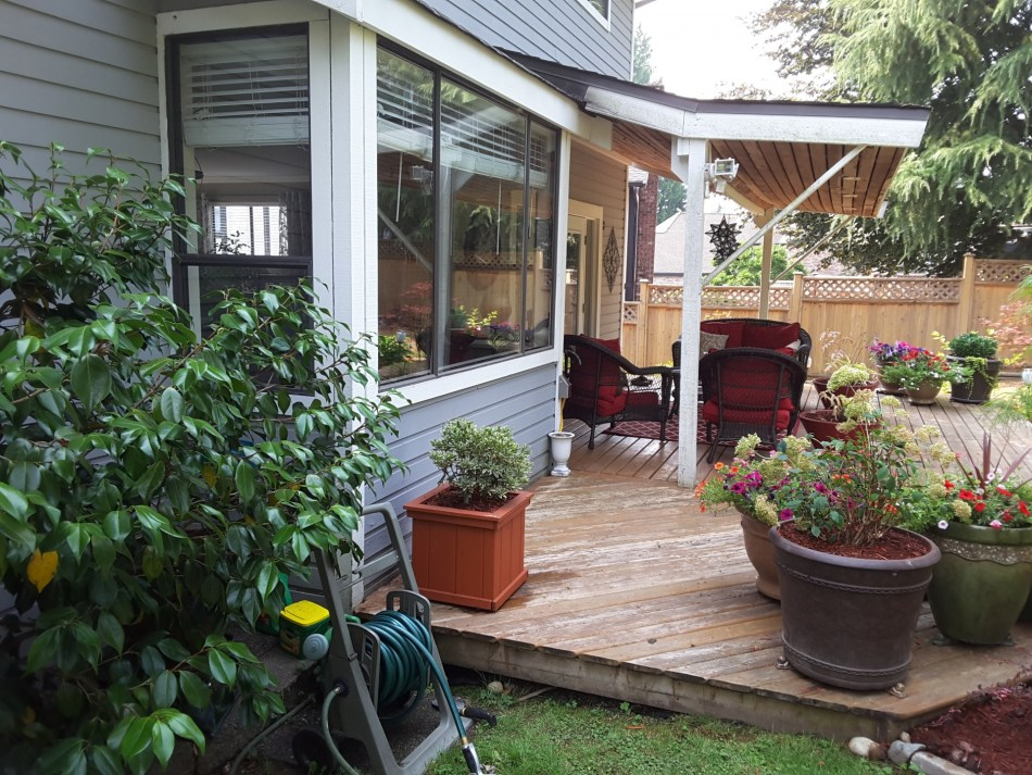 Shady deck with containers.