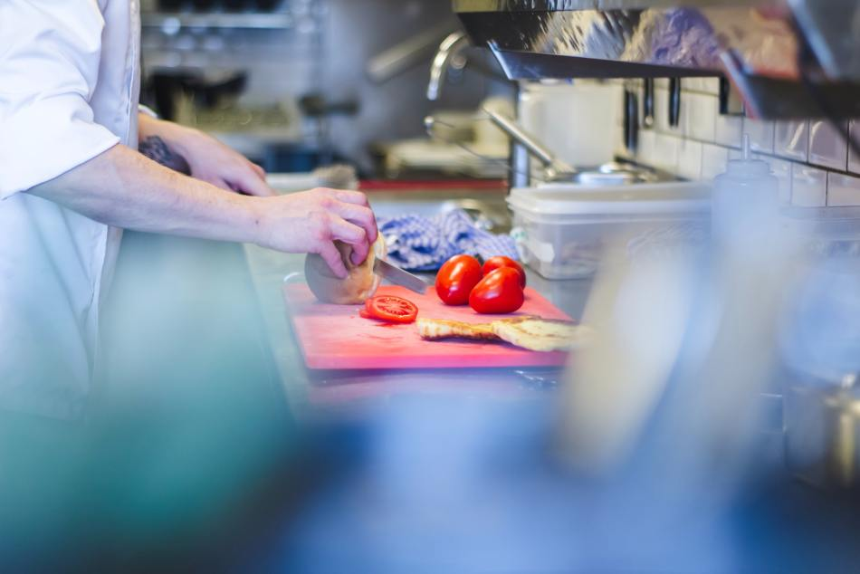 Preparing tomatoes in a kitchen.