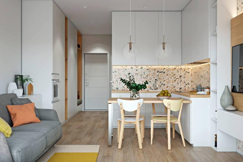 Пространство разделено на две части большими стеклянными раздвижными дверями в стильной и уютной маленькой квартире - прекрасное сочетание чистых белых, светлых пород дерева и терраццо, креативная мебель