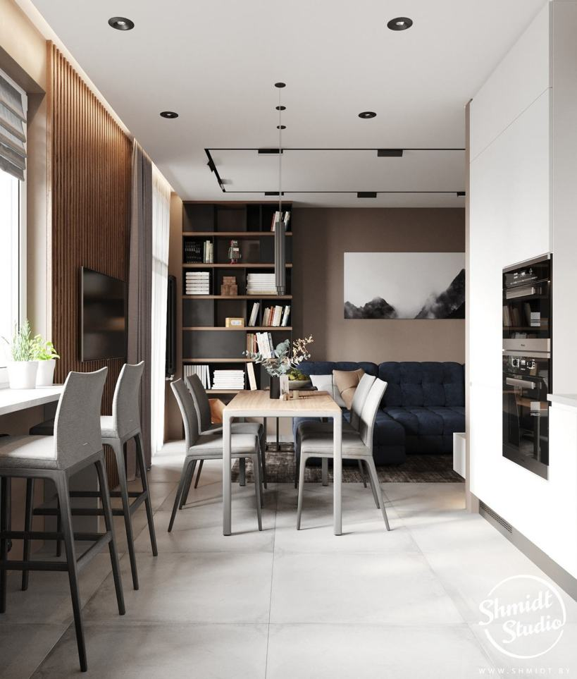 Приятные нейтральные оттенки и глубокий синий диван в сочетании с белым в двухкомнатной квартире.