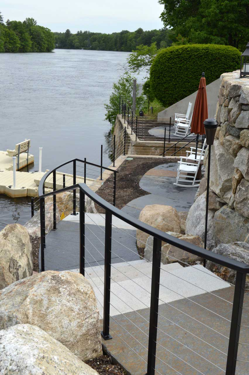 Black iron railing with stainless steel cables