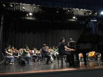 Jordan Ong performing with orchestra, Costa Rica