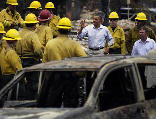 President Barack Obama visited firefighters at the Mountain Shadows neighborhood damaged by the Waldo Canyon Fire in Colorado Springs, Colo., in 2012. More than 30,000 people were evacuated in what was the most destructive wildfire in state history. (Associated Press)