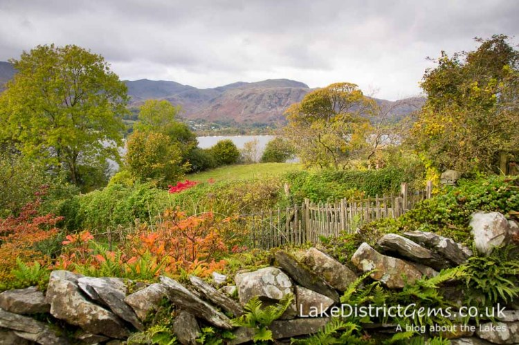 The view over the lower gardens to Coniston Water at Brantwood