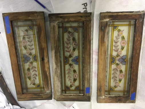 Some of the painted glass panes being prepared for conservation