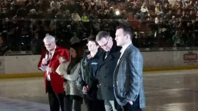 Wife Brett, Daughter Blake, Mom Deanna, Dad Garth, Sons (not shown) Dylan & Caleb stand with Mark Letestu at center ice