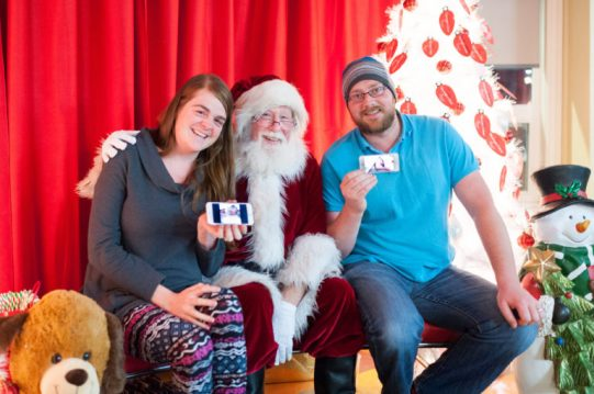 Alana & Adam introducing Elliott & Jack to Santa at RMHCNA.