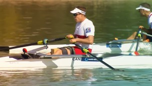 Jeremy Hall rests at the finish line after obtaining a silver medal.