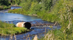 A culvert pushed out into the river.