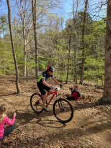 Sims began racing mountain bikes through NICA