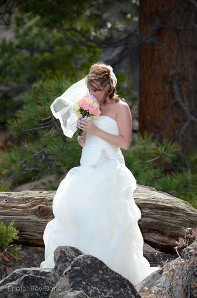 lake tahoe bride smelling flowers