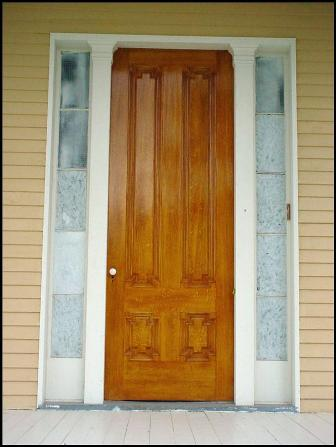 Oak-grained front door reinstalled