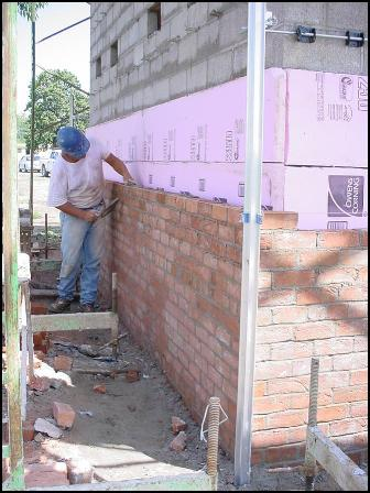 Re-bricking the smokehouse facade