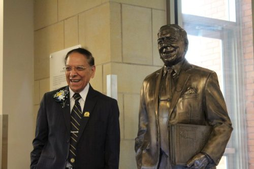 Photo of Dr. Madan Saluja and statue