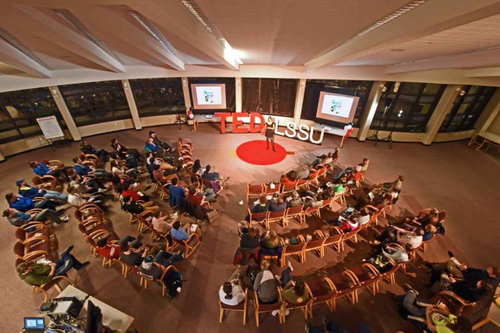 A photo of TEDxLSSU 2016 taking place in the LSSU Library.