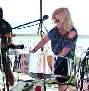 Bickley Rivera takes on a steelpan similar to what she'll play when she attends Panorama next February in Trinidad. Bickley is raising money for the trip, which will include a documentary film crew. (Photo provided)