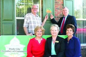 Organizers behind the Paint the Town Kumquat campaign show off the new kumquat-painted shutters at the Greater Dade City Chamber of Commerce office. Participating in the project are, in front from left, project coordinator Lucy Avila, incoming chamber president Bonnie Krummen of CenterState Bank, and Dade City mayor Camille Hernandez. In back, Dade City chamber executive director John Moors, and Saint Leo University media coordinator Kim Payne.