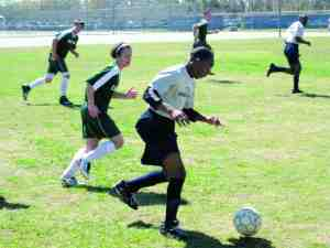 Ordray Smith advances the ball during a soccer game at Wesley Chapel High School during the Pasco County Special Olympics Games on Feb. 28. (Courtesy of Land O' Lakes High School)