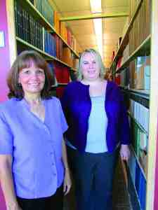 Jackie Bryan, left, and Elana Karshmer recently received a national award for their innovative approach for teaching university students how to use the resources available at the Daniel A. Cannon Memorial Library at Saint Leo University. (B.C. Manion/Staff Photo)