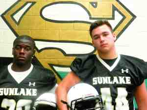 Running back Nathan Johnson, left, and linebacker Austin Yeloushan will be key to Sunlake's fortunes in 2014. (Michael Murillo/Staff Photo)