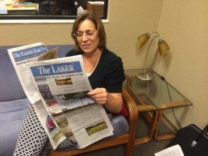The Laker/Lutz News publisher Diane Kortus holds up a brand new paper, which launched Aug. 6. (Photo by Michael Hinman)