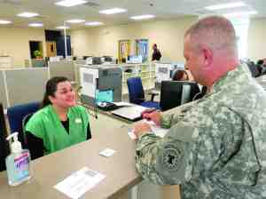 U.S. Army Master Sgt. Robert Knox registers his truck at the new tax collector's office, located off Wesley Chapel Boulevard in Lutz. The location is already drawing around 240 customers a day, exceeding the expectations of Pasco's tax collector, Mike Fasano.   (Michael Murillo/Staff Photo)
