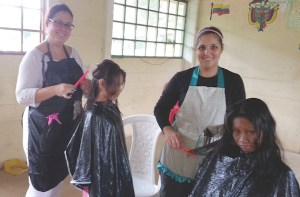Mayra Santiago enlisted the help of fellow church member Mahalie Rivera to cut hair during a mission trip to a small Amazon village in Colombia. (Courtesy of Mayra Santiago)
