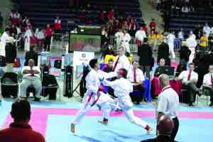 Derick Vo, left, battles an opponent from Portugal at the karate championship in Poland. His performance helped him earn bronze in the event.  (Courtesy of Duy-Linh Vo)