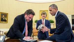 President Barack Obama works on his immigration speech with speechwriters Cody Keenan, left, and David Litt in the Oval Office ahead of the president's Nov. 20 remarks on immigration reform. (Courtesy of Pete Souza)