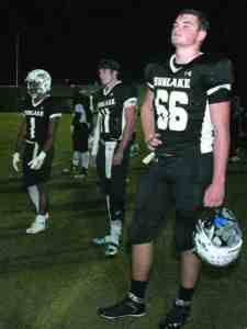Sunlake's Bruce James Cooley, 66, can only watch as the Zephyrhills Bulldogs score a touchdown in the final game of the season, while quarterback Dayton Feiden, 11, and running back Naejaun Jackson, 1, look on. Sunlake finished the season as district champs before being knocked out in the second round of the playoffs. (Fred Bellet/Photo)
