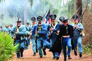 U.S. troops charge during Dade's Battle, an annual re-enactment that occurs at the Dade Battlefield Historic State Park in Bushnell. (Courtesy of Dade Battlefield Historic State Park)