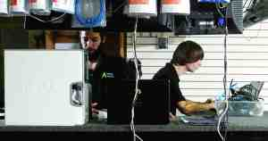 Anything Computers intern, at left, Jesse McGee, 24, and former intern and now store technician Pierce McMenamin, 18, both of Zephyrhills, man the front end of the store and tackle technical issues for customers and stay busy resolving the computer issues of customers. (Fred Bellet/Photo)