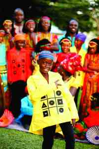 The Watoto Children's Choir is touring around the Southeastern United States, including stops in Wesley Chapel, Lutz and Tampa. Allan Nyakaana takes center stage here. (Courtesy of Watoto Children's Choir)