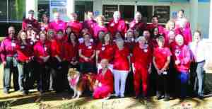 "Members of the staff and volunteers at Regional Medical Center Bayonet Point gathered for a group photo on National Wear Red Day on Feb. 7. Even ""Lucky,"" the hospital's therapy dog, got into the act. (Courtesy of Regional Medical Center Bayonet Point)"